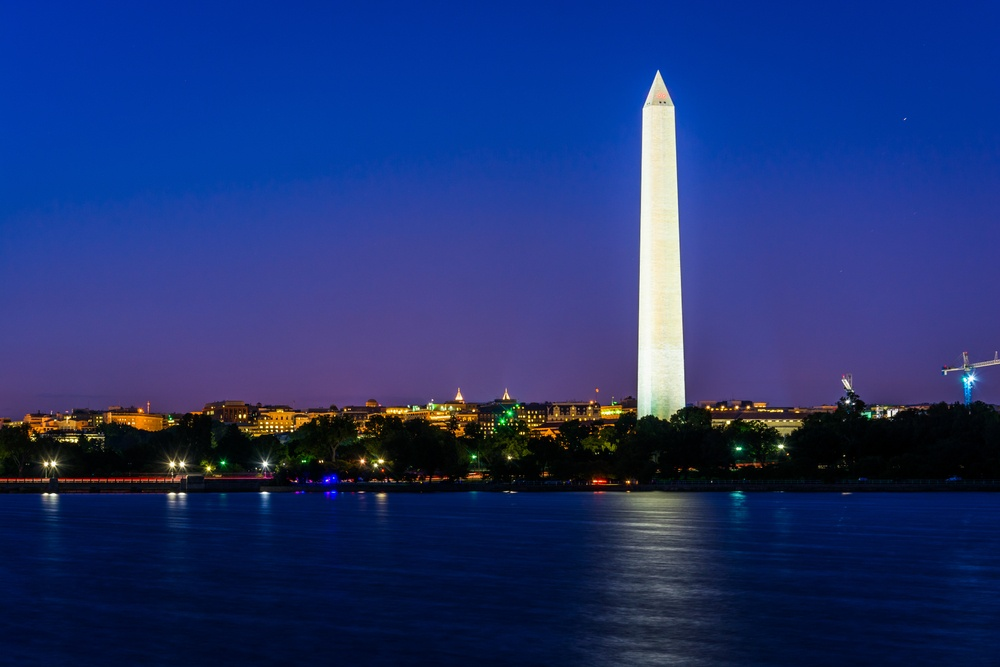 The Washington Monument and Tidal Basin at night in Washington, DC.