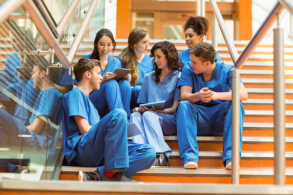 Medical students taking a break on the steps at the university