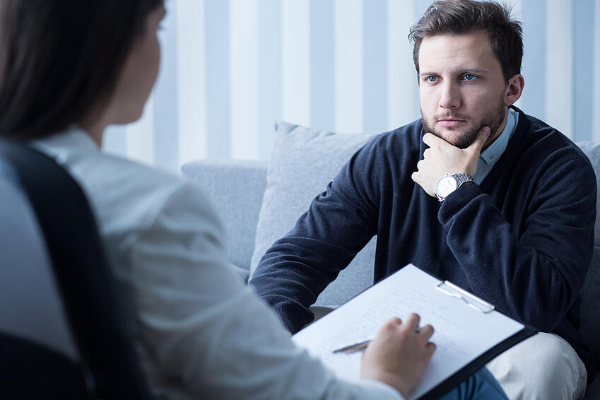 Young man during therapy at psychologist's office